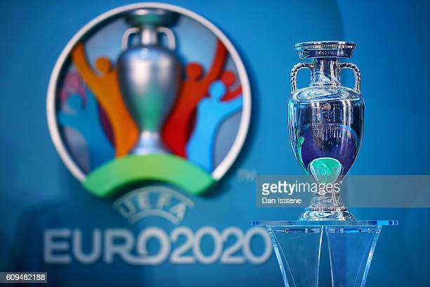 The UEFA European Championship trophy is displayed next to the logo for the UEFA EURO 2020 tournament during the UEFA EURO 2020 launch event for...