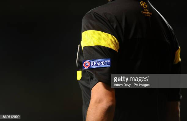 The UEFA Respect logo on the sleeve of the referee