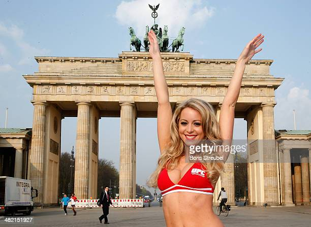 The UFC Octagon Girl Carly Baker poses ahead of the UFC Fight Night Berlin at Brandenburg Gate on March 22 2014 in Berlin Germany