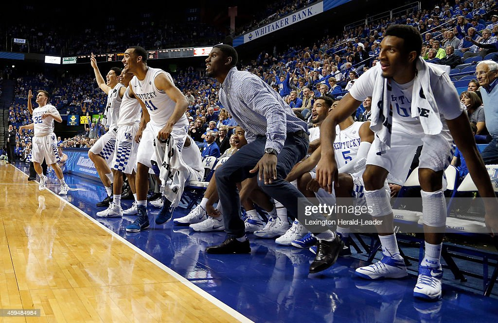 The UK bench including Kentucky Wildcats forward Alex Poythress in street clothes is ready to explode as Kentucky guard Brian Long misses a long...