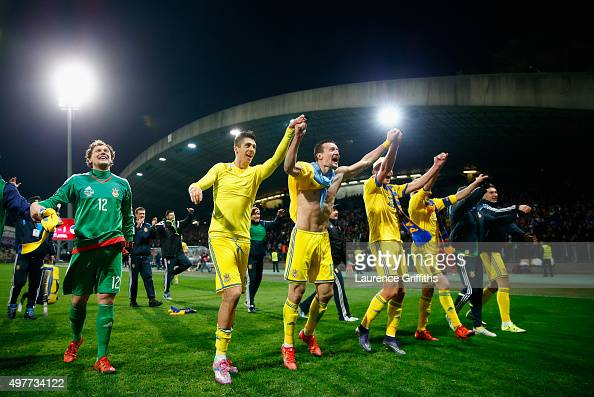The Ukraine Team celebrates qualification with the fans after the UEFA EURO 2016 qualifier playoff second leg match between Slovenia and Ukraine at...