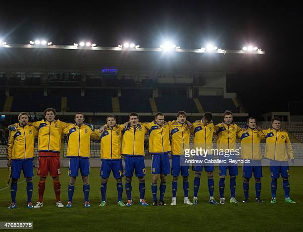 The Ukraine team stands for the national anthem during the Ukraine v USA International Friendly at Antonis Papadopoulos stadium on March 5 2014 in...