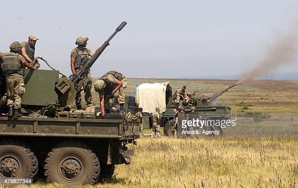 The Ukrainian army holds a military training drill near the city of Mariupol in the country's southeast on July 7 2015 Military forces posted to the...