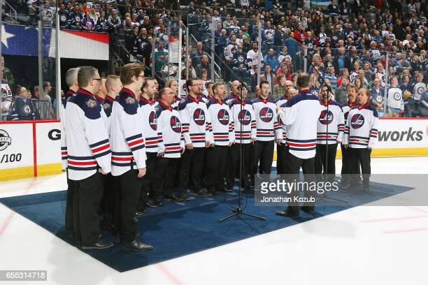 The Ukrainian Mens Choir performs the National anthems prior to NHL action between the Winnipeg Jets and the Minnesota Wild at the MTS Centre on...