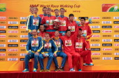 The Ukrainian Russian and Chinese teams celebrate on the podium at award ceremony of Men's 50km Race Walk on May 3 2014 in Taicang China
