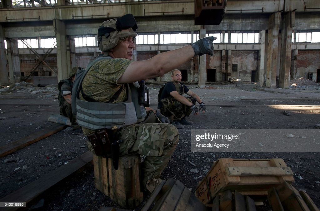The Ukrainian soldiers make preparations during the fight with the pro-Russian separatists at the Avdiivka industrial zone (Promka) in Avdiivka, Donetsk region, Ukraine, June 25, 2016.