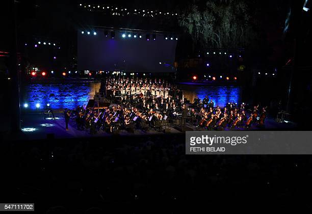 The Ukrainian Symphony Orchestra performs during the opening of the Carthage Festival on July 13 2016 at the Roman theatre of Carthage near Tunis /...