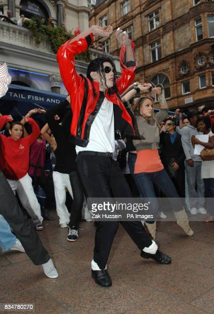 The UK's number one Michael Jackson lookalike known as 'Navi' is joined by fans to reenact the famous dance from 1983's iconic Thriller video in...