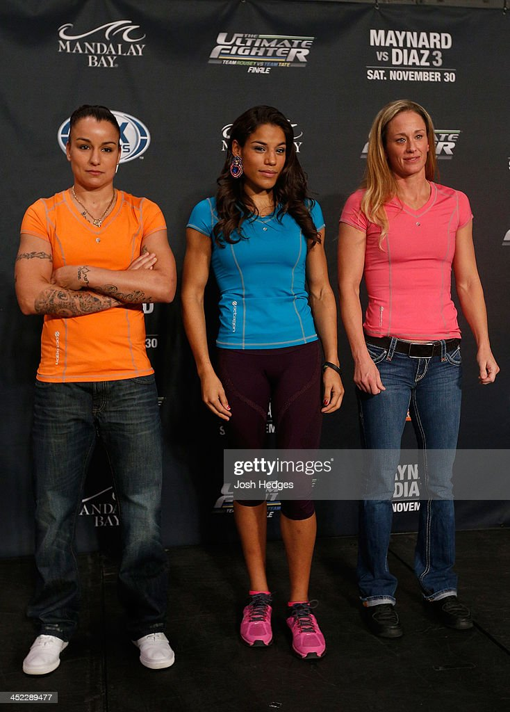 The Ultimate Fighter women's bantamweight contenders Raquel Pennington, Julianna Pena, and Jessica Rakoczy pose for a photo during media day ahead of The Ultimate Fighter season 18 live finale inside the Mandalay Bay Events Center on November 27, 2013 in Las Vegas, Nevada.