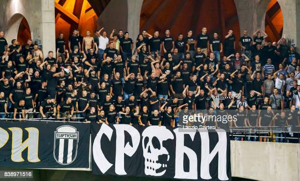 The ultras of FK Partizan incite their team during the UEFA Europa League Playoffs 2nd Leg match between Videoton FC and FK Partizan at Pancho Arena...