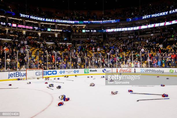 The UMass Lowell Riverhawks throw their gear in celebration after their win the Hockey East Conference Championship game against the Boston College...