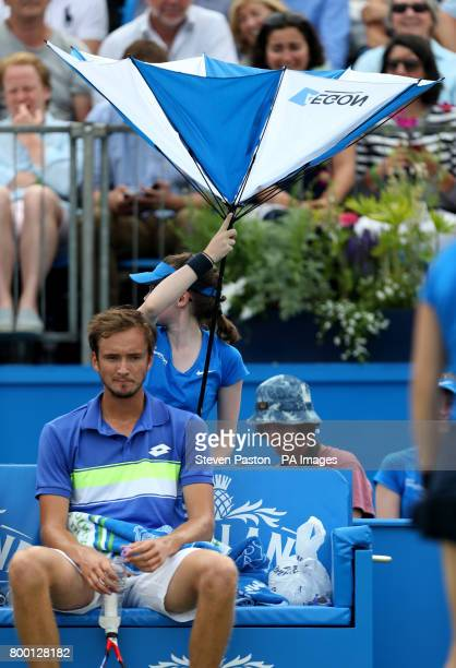 The umbrella which is meant to be shielding Russia's Daniil Medvedev opens the wrong way during day five of the 2017 AEGON Championships at The...