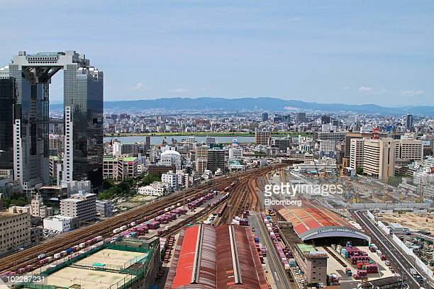 The Umeda Sky Building left stands next to the construction site of the first stage of the Osaka Station North District project known as 'Kita Yard'...