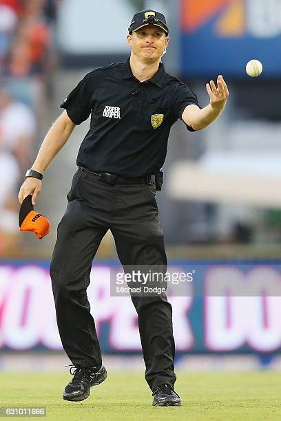 The umpire gets a replacement ball after Brendon McCullum of the Heat hits Andrew Tye of the Scorchers for six during the Big Bash League match...