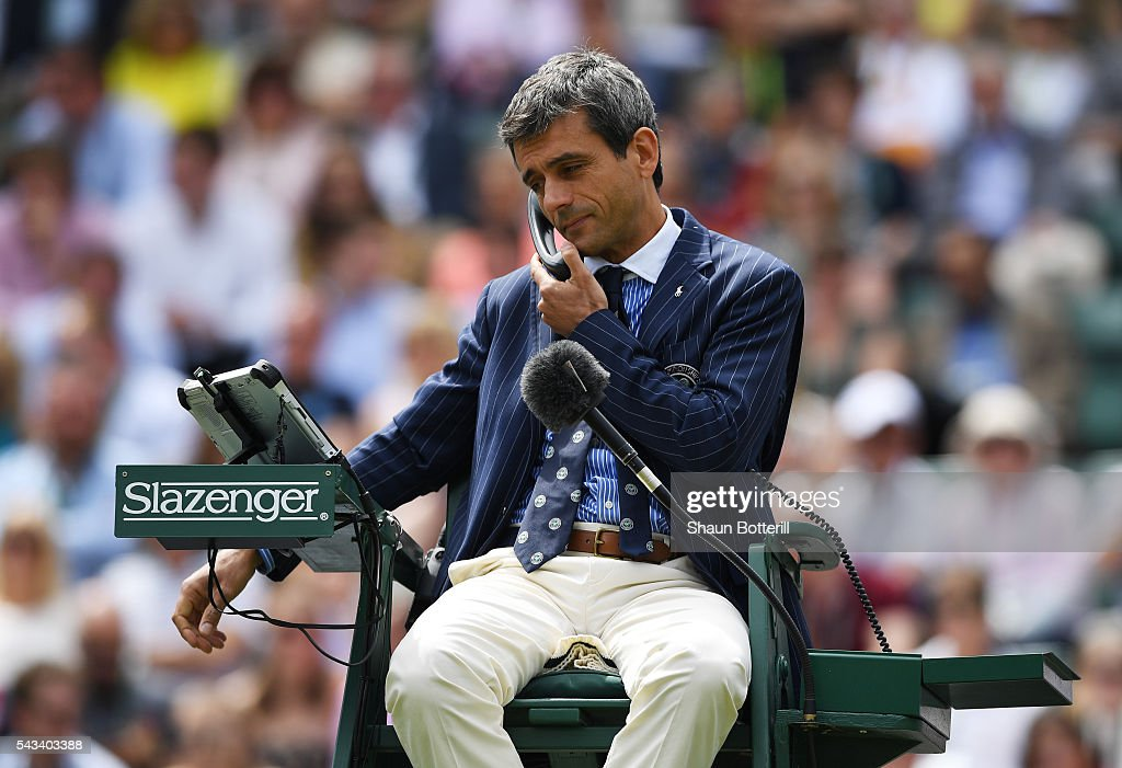 The Umpire is on the phone during the Men's Singles first round match between Taylor Fritz of The United States and Stan Wawrinka of Switzerland on day two of the Wimbledon Lawn Tennis Championships at the All England Lawn Tennis and Croquet Club on June 28, 2016 in London, England.