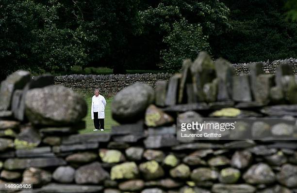 The Umpire pictured through a gap in the old dry stoned wall that surround Coniston Cricket Club the ground nestled at the foot of the 'Old Man of...
