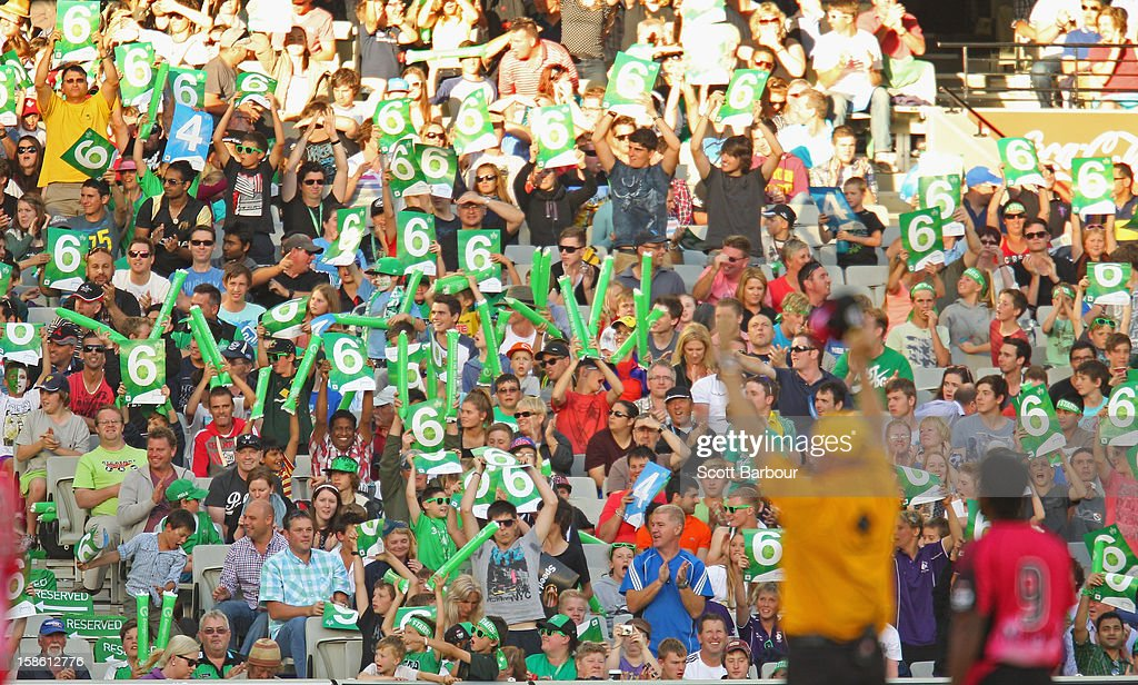 The umpire signals after a six was hit by the Stars during the Big Bash League match between the Melbourne Stars and the Sydney Sixers at Melbourne Cricket Ground on December 21, 2012 in Melbourne, Australia.