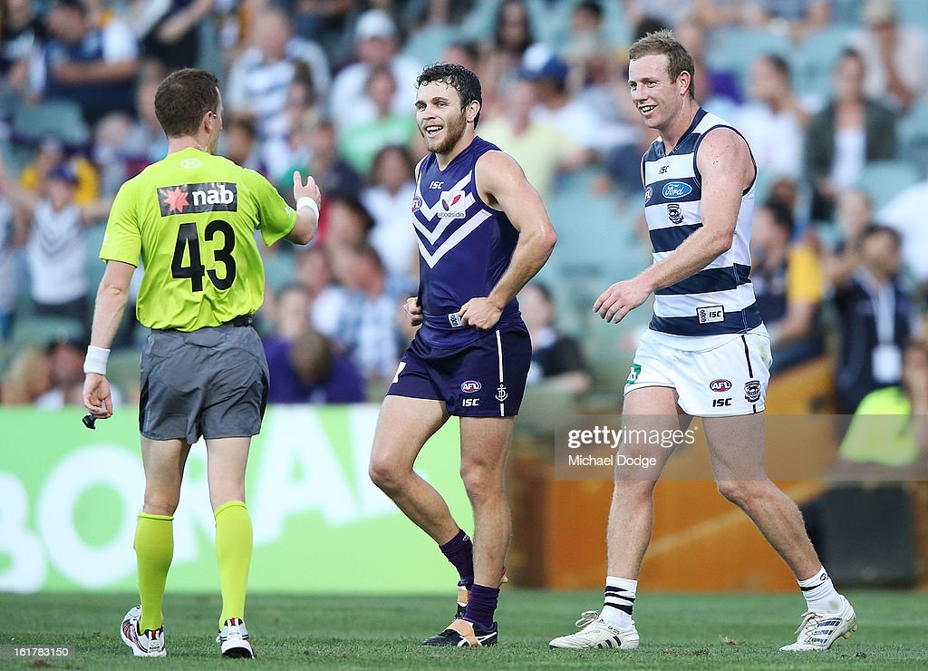 The umpire talks to Steve Johnson (R) of the Geelong Cats and Hayden Ballantyne of the Fremantle Dockers during the round one NAB Cup AFL match between the Fremantle Dockers and the Geelong Cats at Patersons Stadium on February 16, 2013 in Perth, Australia.