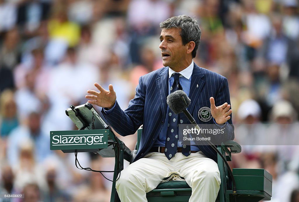 The Umpire watches on during the Men's Singles first round match between Taylor Fritz of The United States and Stan Wawrinka of Switzerland on day two of the Wimbledon Lawn Tennis Championships at the All England Lawn Tennis and Croquet Club on June 28, 2016 in London, England.