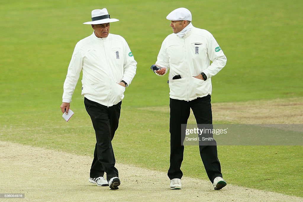 The umpires discuss concerns over low levels of light as play is suspended during day three of the Specsavers County Championship: Division One match between Yorkshire and Lancashire at Headingley on May 31, 2016 in Leeds, England.