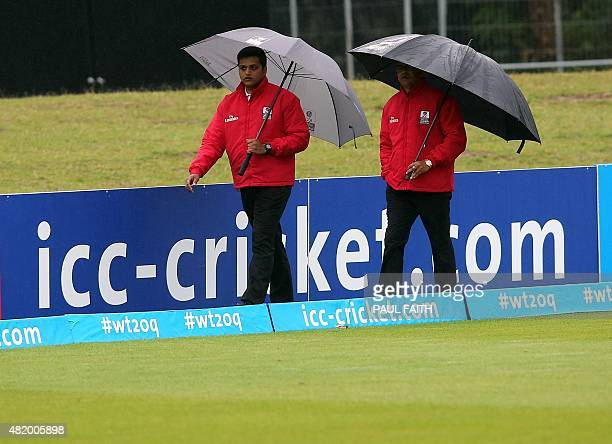 The umpires inspect the rainsoaked outfield ahead of the ICC World Twenty20 3rd Place playoff game between Ireland and Hong Kong at Malahide cricket...