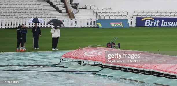 The umpires M Bondenham and Mark Benson inspect the playing area alongside Surrey's Captain Rory HamiltonBron and Durham's Captain Paul Mustard...