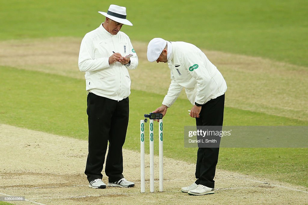 The umpires use a light meter to measure the light levels during day three of the Specsavers County Championship: Division One match between Yorkshire and Lancashire at Headingley on May 31, 2016 in Leeds, England.