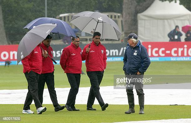 The umpires with head groundsman Phillip Frost inspect the rain soaked ground ahead of the ICC World Twenty20 3rd Place final game between Ireland...
