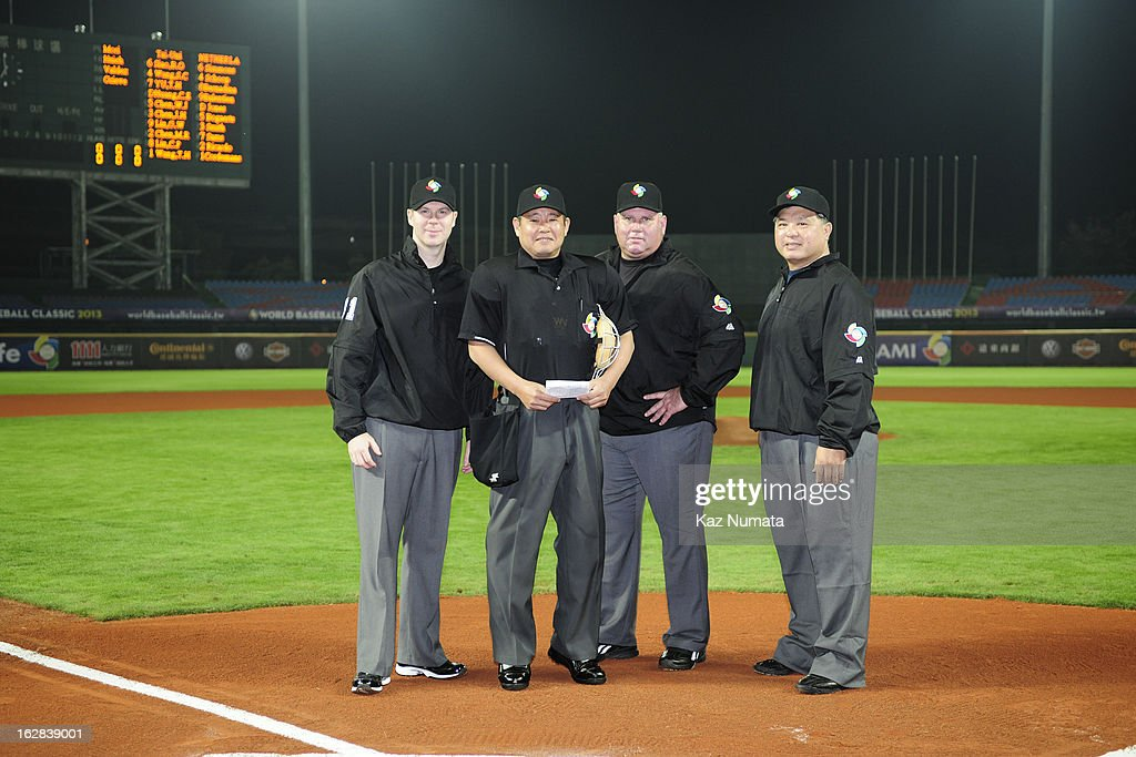 The umpiring crew poses for a photo at home plate before the World Baseball Classic exhibition game between the Industrial All-Star Team and Team Netherlands at Intercontinental Stadium on Tuesday, February 26, 2013 in Taichung, Tawain.