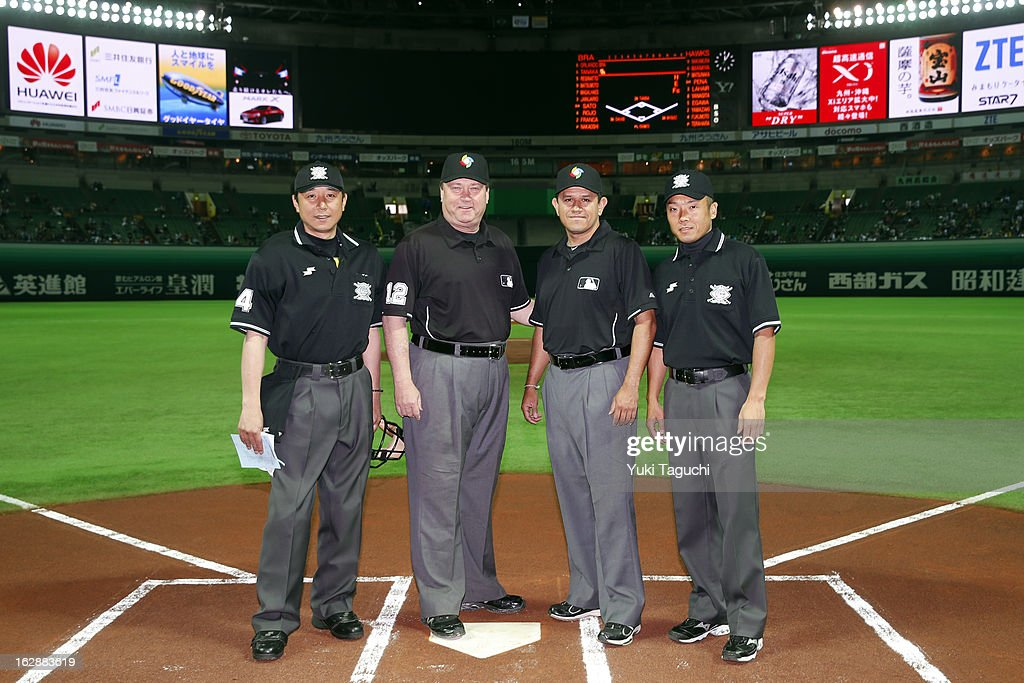 The umpiring crew poses for a photo at home plate before the World Baseball Classic exhibition game between Team Brazil and the SoftBank Hawks at the Fukuoka Yahoo! Japan Dome on Thursday, February 28, 2013 in Fukuoka, Japan.