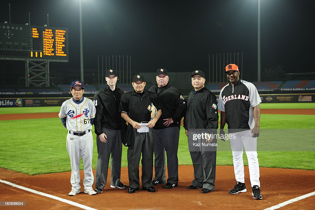 The umpiring crew poses for a photo with Hensley Muelens #31 manger of Team Netherlands and the manager of the Industrial All-Star Team before the World Baseball Classic exhibition game between the Industrial All-Star Team and Team Netherlands at Intercontinental Stadium on Tuesday, February 26, 2013 in Taichung, Tawain.