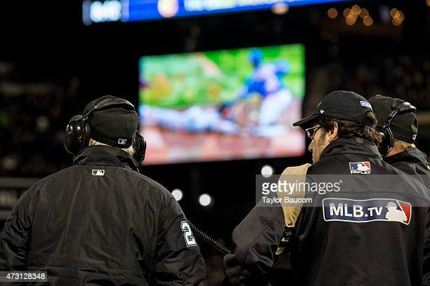 The Umpiring crew reviews a play with Instant Replay during the game between the Washington Nationals and New York Mets at Citi Field on Friday May 1...
