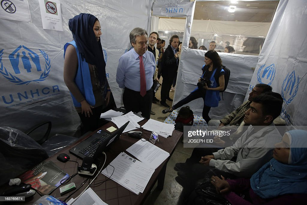 The UN High Commissioner for Refugee's Antonio Guterres (C) meets Syrian refugees at the UNHCR registration centre in the northern Lebanese city of Tripoli on March 15, 2013. Guterres said the number of Syrian refugees could double or triple by the end of the year if no solution is found to the conflict.