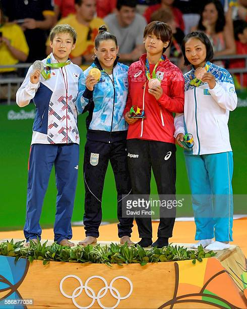 The under 48kg women medallists BoKyeong Jeong of South Korea Paula Pareto of Argentina Ami Kondo of Japan and Otgontsetseg Galbadrakh of Kazakhstan...