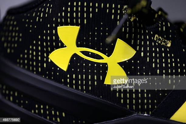 The Under Armour logo is displayed on the new Stephen Curry basketball shoe at T B Sports on October 22 2015 in San Rafael California Under Armour...