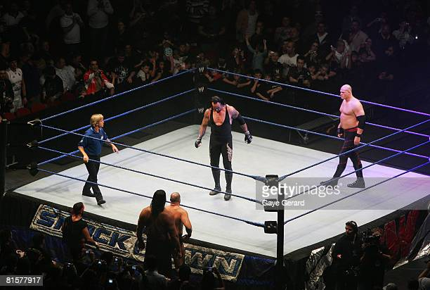 The Undertaker and ECW Champion Kane stand in the ring as the look down to Bam Neely Chavo Guerrero and The Great Khali during WWE Smackdown at Acer...