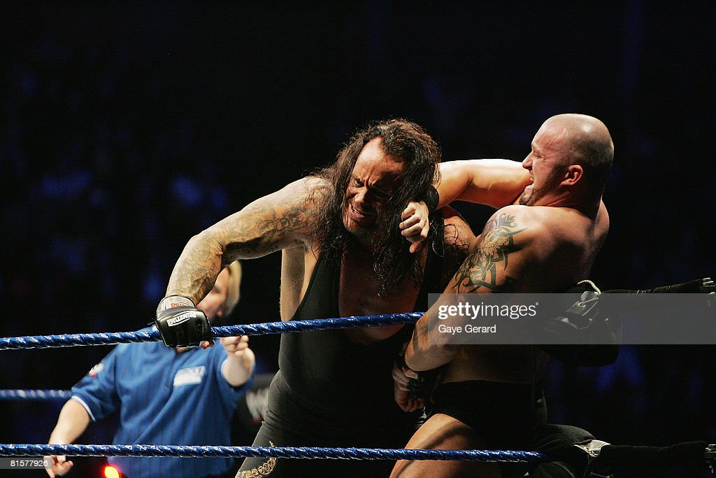 The Undertaker pushes Bam Neely into the corner during WWE Smackdown at Acer Arena on June 15 2008 in Sydney Australia