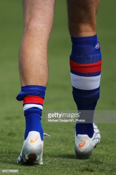 The uneven socks of Jordan Roughead of the Bulldogs reacts after a near wicket seen during the 2017 JLT Community Series match between the Western...