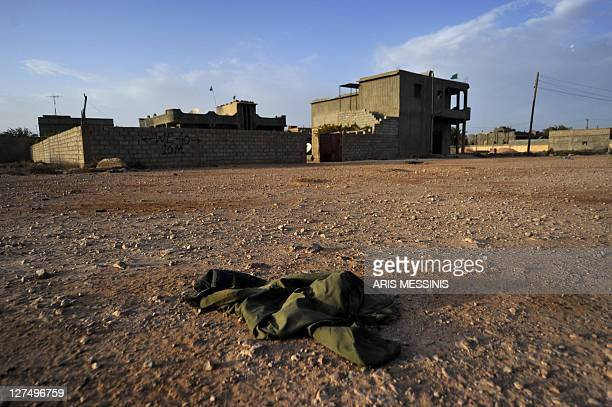 The uniform of a Libyan loyalist soldier lies on the ground in Tawarga on September 25 2011 The people of Tawarga who are mostly blackskinned Libyans...