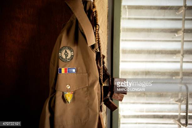 The uniform of a ranger with the Chadian Zakouma National ParK February 20 2014 hangs with some charms at the park headquarters Elephant hunting or...