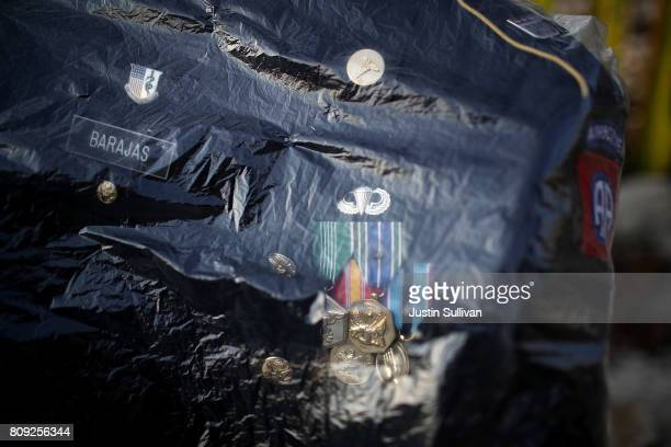 The uniform of deported US Army veteran Hector Barajas sits in a plastic bag during a Fourth of July gathering next to the USMexican border fence on...
