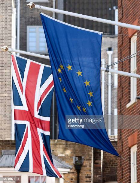 The Union flag also known as the Union Jack left flies next to a European Union flag outside Europa House in London UK on Monday March 13 2017 The...