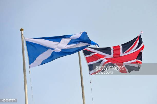 The Union Flag and Saltire the national flag of Scotland are flown above above Horseguards in central London on September 17 ahead of the referendum...