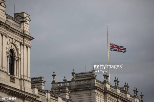 The Union flag flies at half mast above the Department for Culture Media and Sport on Whitehall on May 23 2017 in London England Prime Minister...