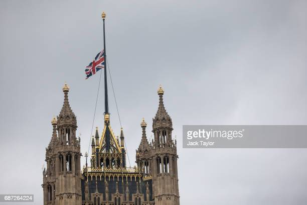 The Union flag flies at half mast above the Houses of Parliament in Westminster on May 23 2017 in London England 22 people including children have...