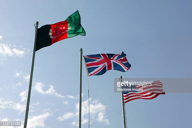 The Union Flag of the United Kingdom between the Afghanistan and United States flags.