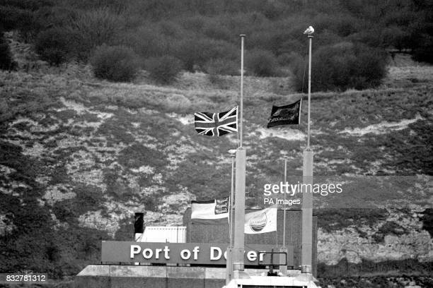 The Union Jack and other flags fly at half mast on Townsend Thoresen's headquarters at Dover as the rescue operation continues off Zeebrugge Belgium...