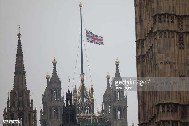 The Union Jack flag flies at half mast above the Houses of Parliament following Wednesday's attack on Westminster on March 24 2017 in London England...