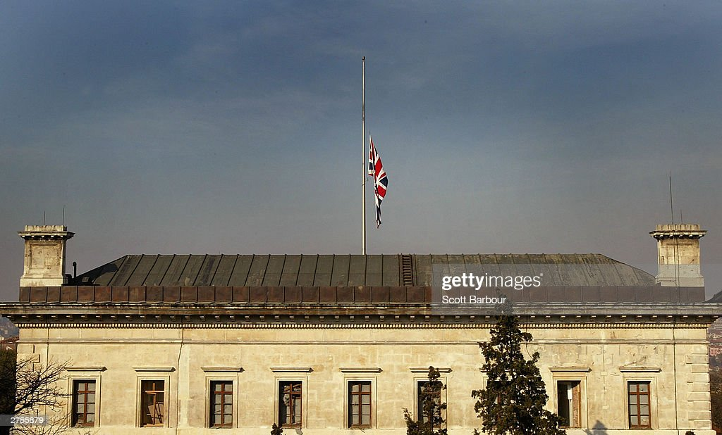 The Union Jack flag flies at half mast on top of the damaged British Consulate November 23, 2003 in Istanbul, Turkey. Bomb attacks on the British consulate and the HSBC bank headquarters on November 20, 2003 killed 27 people and left hundreds injured.