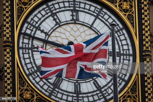 The Union Jack flag flies from a flagpole on Portcullis House in front of the Elizabeth Tower commonly known as Big Ben on March 1 2017 in London...
